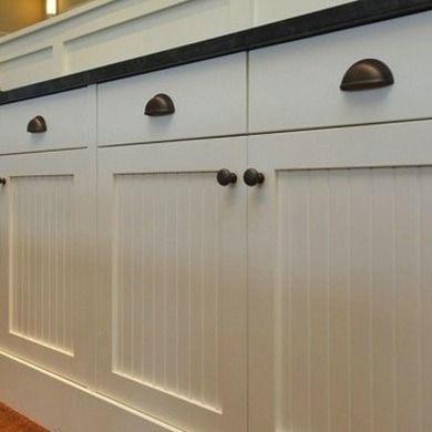 Farmhouse - Kitchen Hardware Ideas - Bob Vila; Beadboard and oil rubbed bronze hardware.