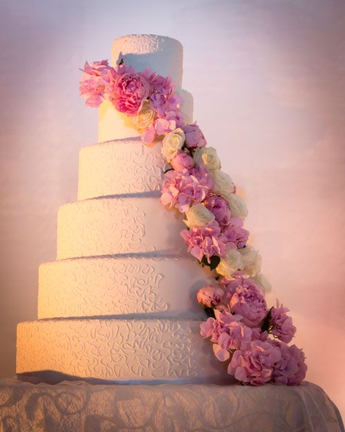 A cake of cascading peonies graced the table at a spring wedding at The Ritz-Carlton, Dubai International Financial Center.