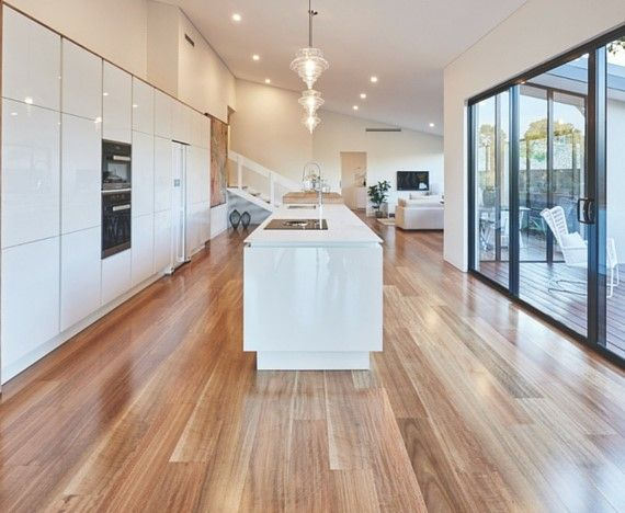 HM Walk - Spotted Gum. HM WALK is an engineered hardwood floor, which means that the surface you WALK on and see is made of strong Australian hardwood, while underneath the surface HM WALK uses an extremely stable 9 ply construction made of plantation Eucalypt. This type of construction ensures the maximum use of our precious hardwood, which in turn is better for the environment. Available at Alstonville Tiles & Floorcoverings
