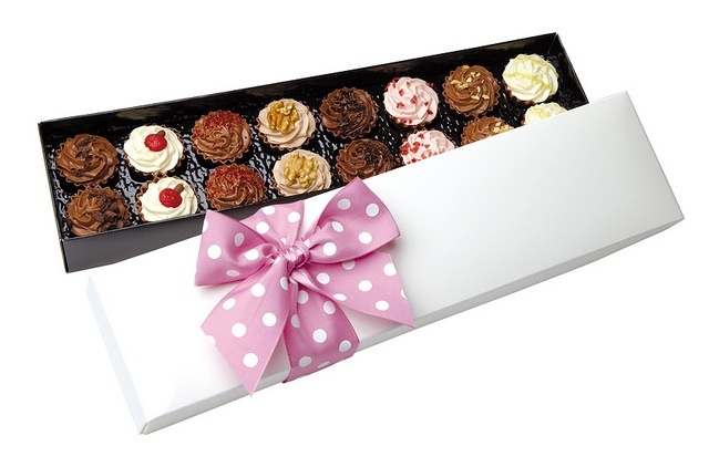 Box of 16, luxury mini chocolate cupcakes, in cupcake flavours.  Great for a gift, favours or an after chocolate for your guests.  The beautiful chocolates look great presented on a vintage cake stand or on the side of a teacup and saucer.  £17.99, order online at the Fuschia Boutique at www.fuschiadesigns.co.uk.