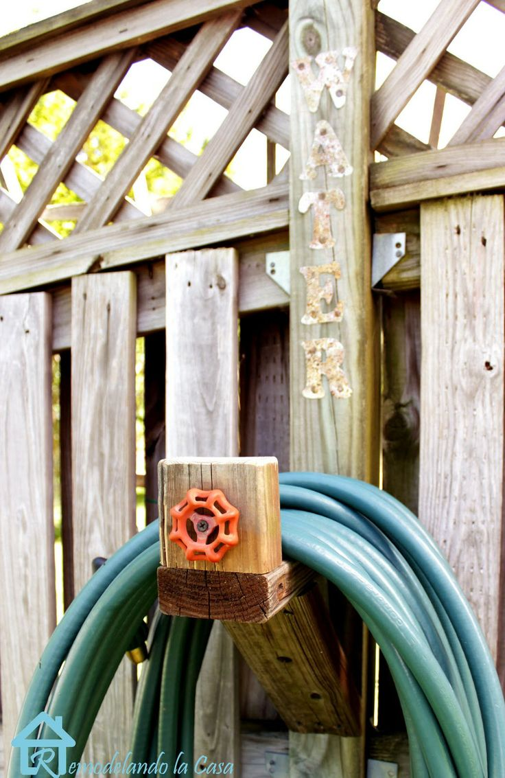 1000 ideas about water hose holder on pinterest hose for Diy garden hose storage