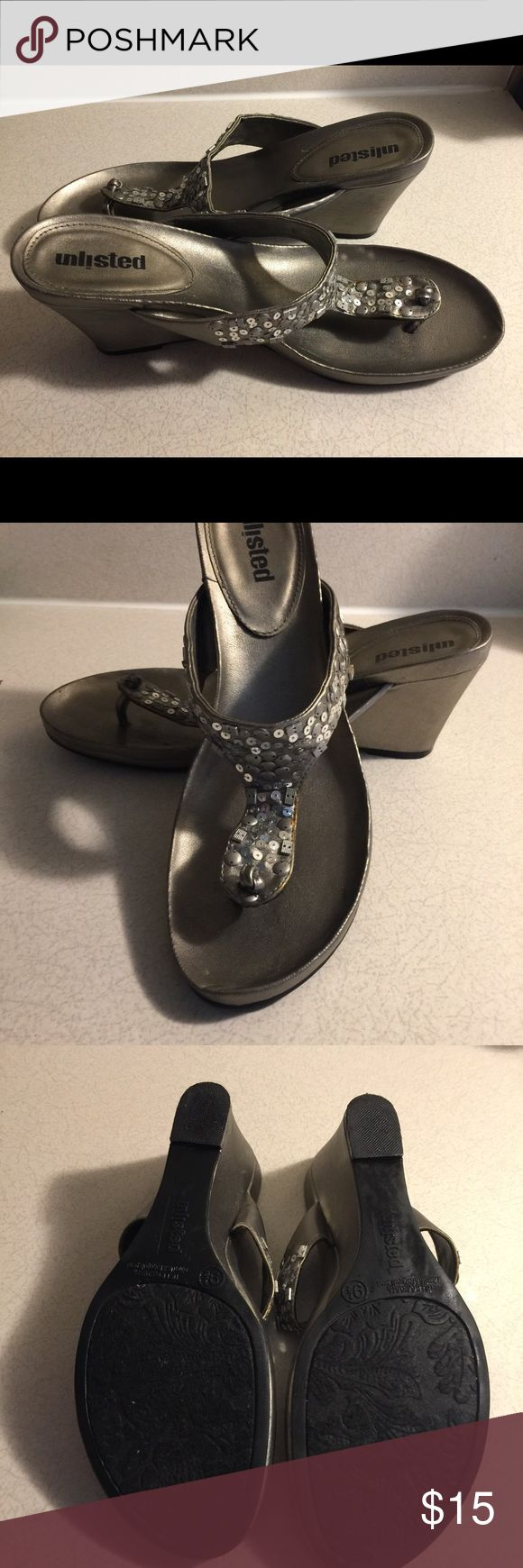 Unlisted, women's size 9.5 Sequined Wedge Sandals These beautiful sandals are silver and sequins, ready to dress up any outfit. They have a 3 inch wedge heel and look great with jeans, shorts, or a dress/skirt. They are pre-owned but they are in great condition. Unlisted Shoes Sandals