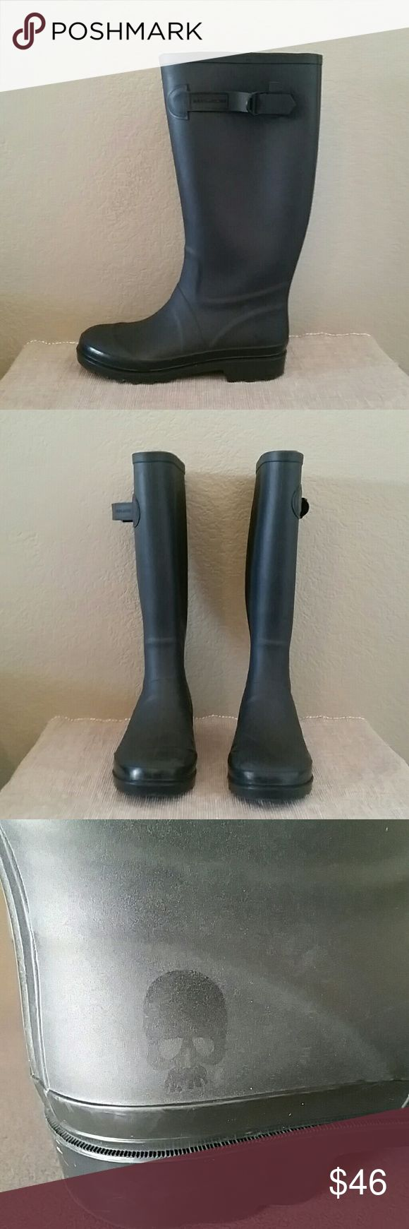 Marc Jacobs skull matte rubber rain boots Buckle Marc Jacobs black rubber rain boots, matte, plastic buckle detail, skull on outside heel, 1 1/2 inch heel, 14 1/4 total boot height, pre-owned, see pics for marks, size 37 Marc Jacobs Shoes Winter & Rain Boots
