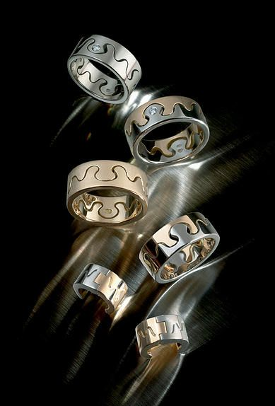 Saarikorpi Design, Puzzle I rings, 18K white and yellow gold, diamonds
