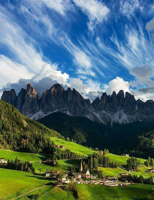 Wonderful clouds over a picturesque village in Italy.