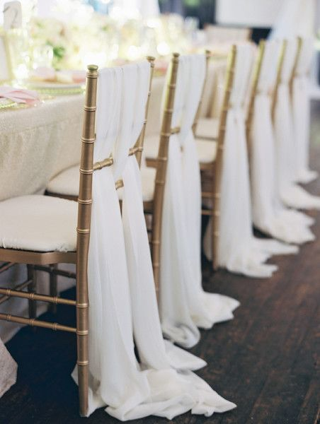 Grecian-style draping on gold #chivari chairs I Elle Ellinghaus Designs I #chairdecor
