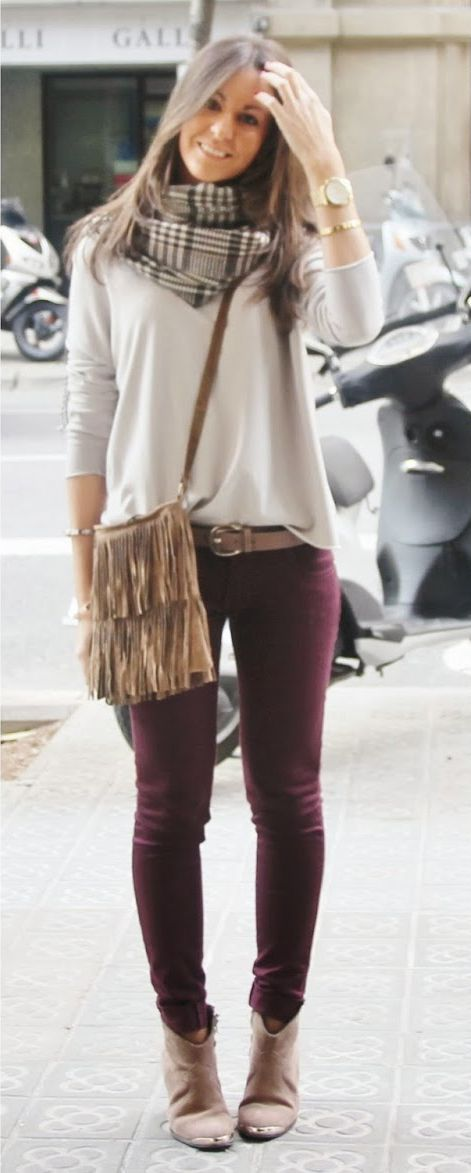 grey or white long sleeve sweater with printed scarf, burgundy jeans, again it's the contrast that will work.