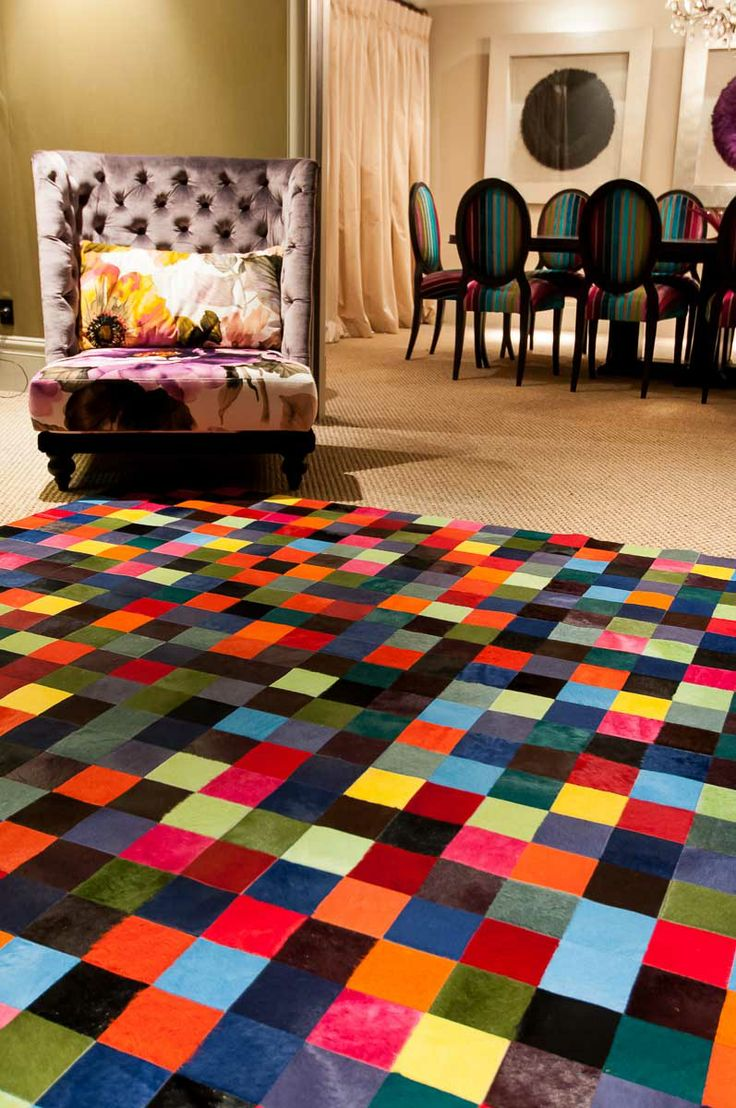 The Pixel multi coloured cowhide rug design by Gorgeous Creatures uses 10cm squares of colourful dyed cowhide to create a stunning colorful rug.