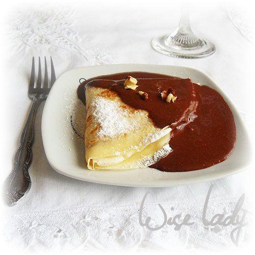 Gundel Pancake: Ingredients ― crepes; filling ~ walnuts; cream; raisins; sugar; cinnamon; orange peel; rum; sauce ~ egg yolks; chocolate; cocoa powder; sugar; butter; milk; vanilla; rum. Instructions ― Filling ~ Combine nuts, sugar, cinnamon, orange zest, raisins; add cream; mix; cook; cool; add rum. Sauce ~ Combine vanilla and milk; beat egg yolks and sugar together; add to milk; stir; cook; add cocoa powder and chocolate; stir; add butter; stir; add rum. Assemble pancakes. #Budapest…