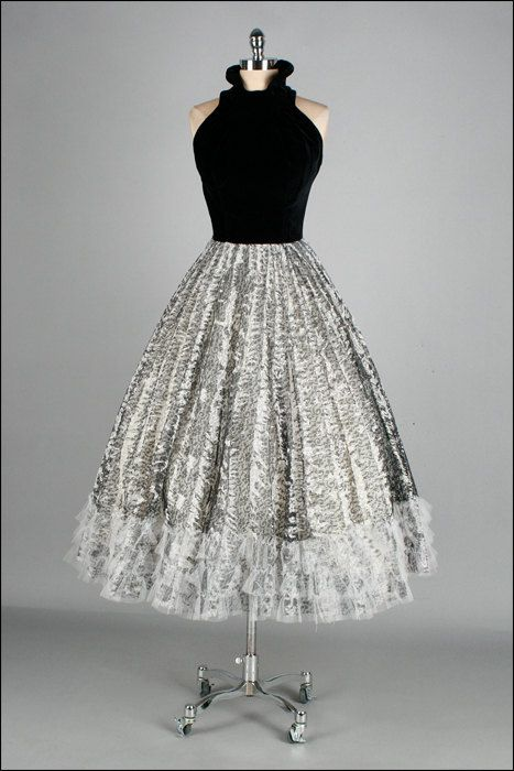 1950's dress with a black velvet bodice and white and black skirt. Love this!
