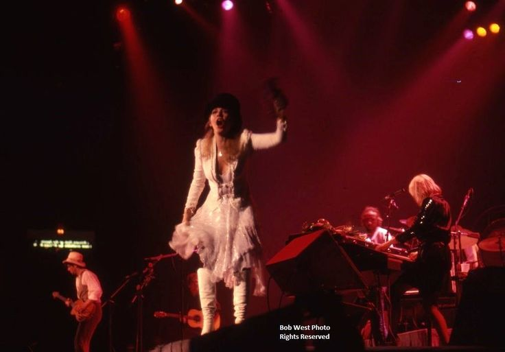 Stevie  ~ ☆♥❤♥☆ ~    wearing her top hat and an awesome all white outfit onstage, performing 'Go Your Own Way' which many in the know and in the audience rephrased it to 'Grow Your Own Hay'; photo by Bob West ~  https://en.wikipedia.org/wiki/Go_Your_Own_Way  ~  http://www.fleetwoodmac.net/penguin/interpretations/g/goyourownway.htm