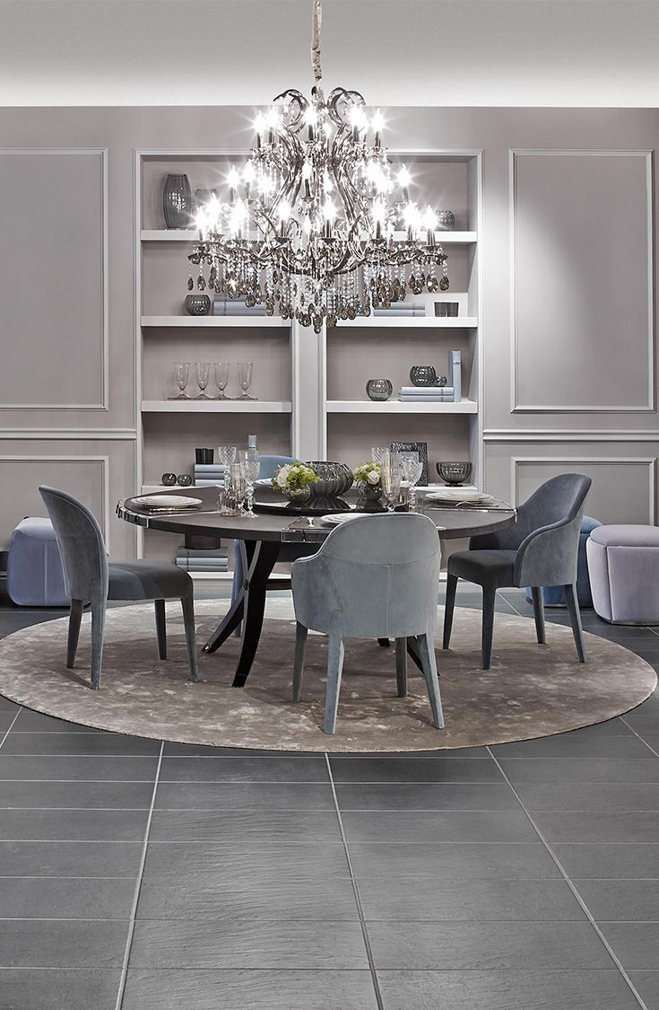 Cool elegance with cream and blue by Fendi Casa. Brunello table and Audrey armchairs and to give it a spark Crystal Palais Royal Chandelier. Luxury Living Group
