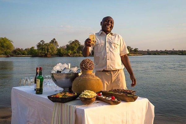 Sundowners overlooking the mighty Zambezi River, just upstream from the Victoria Falls - does Friday night get better than this?