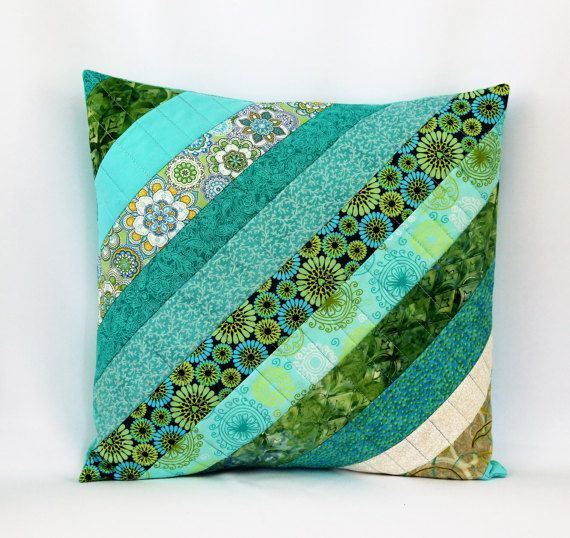 Aqua Quilted Pillow, Throw pillow, Quilted Pillow Cover, 16 X 16 Pillow Sham, Blue Green Aqua, Decorative Pillow, Patchwork Pillow ❤Handmade Patchwork Pillow ❤️16 X 16 Pillow Cover ❤️Ready to Ship ❤️Envelope Back This gorgeous Aqua quilted throw pillow cover measures a generous 16.5 x16.5 inches and is made of quality 100% cotton fabric. It features exquisite spring shades of blue, green, aqua and cream. The backing material is in a coordinating batik fabric of turquoise. This quilted…