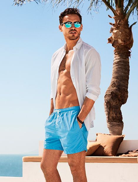 Men | Swimwear | H&M GB|  Vibrant blue swimming trunks great for summer vacations at the pool or beach.