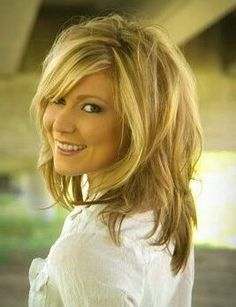 Medium length hair with soft messy layers and side bangs