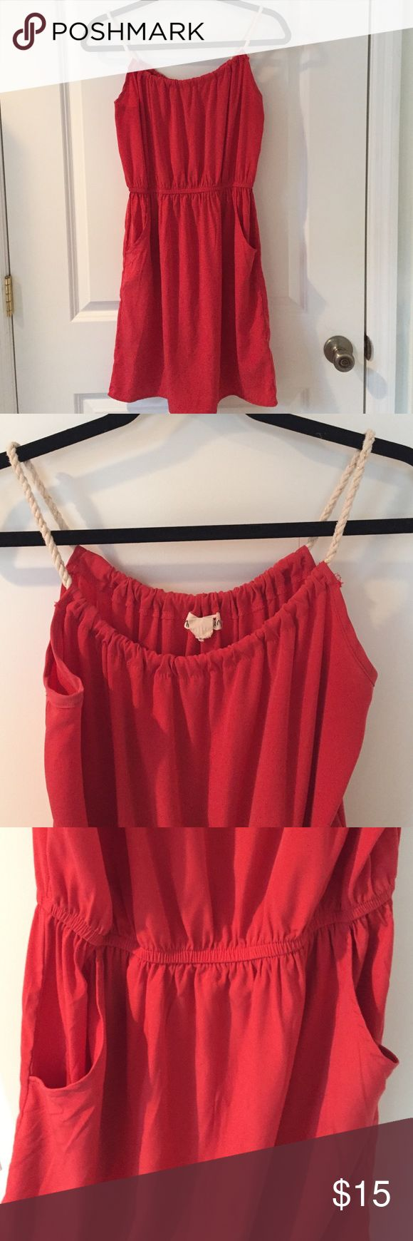 """Coral sundress Really cute coral dress that cinches at the waist for a flattering fit. Top has braided """"rope"""" detail and the dress has pockets. Looks really cute as a swimsuit coverup too! Dresses"""