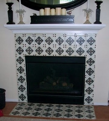 This lady can do anything! These fireplace tiles were boring brown before.