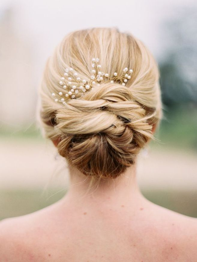 Pair a pretty updo with a delicate hairpiece for a stunning wedding day look. (Coiffure Pour Gala)