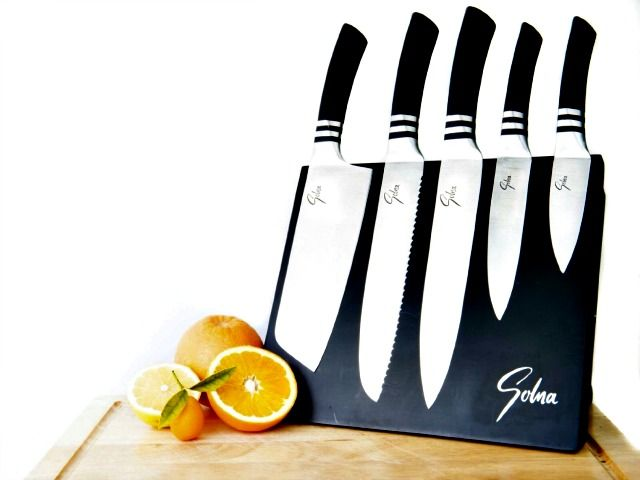 This stainless steel cooking knife set features a magnetic cutting board that allows for storing and showcasing them conveniently!