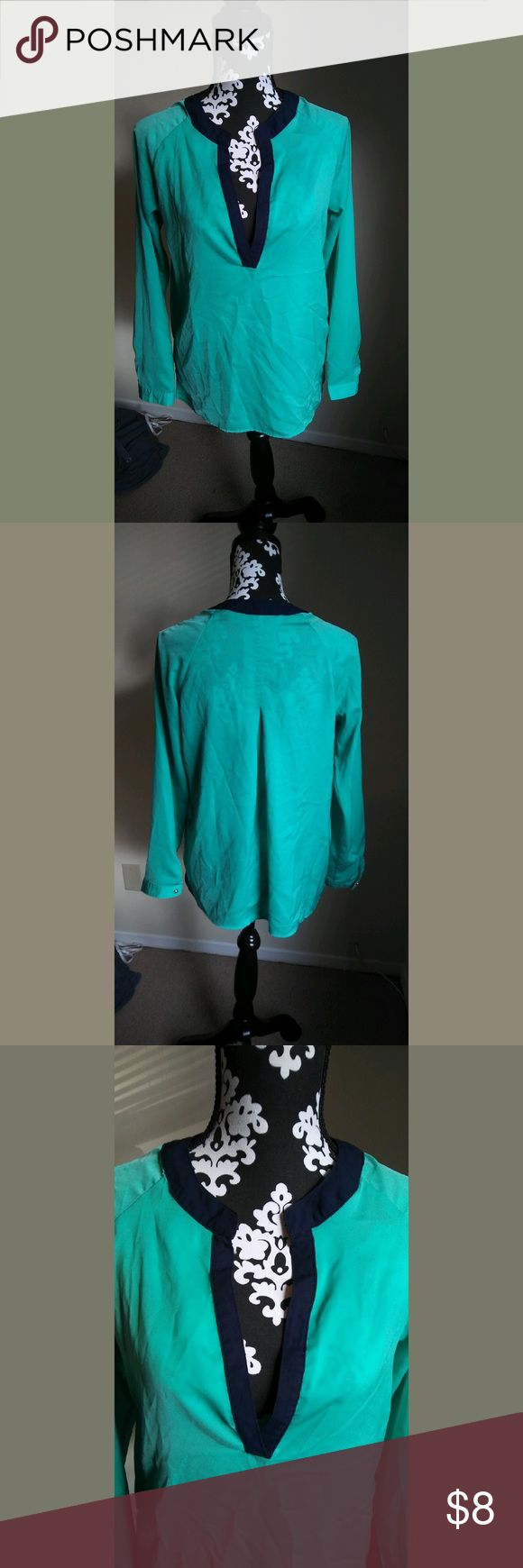 Navy and Turquoise Shirt Super cute navy and turquoise v neck! No problems, just a little wrinkled! Barely ever worn! Size S Buttons Tops Blouses