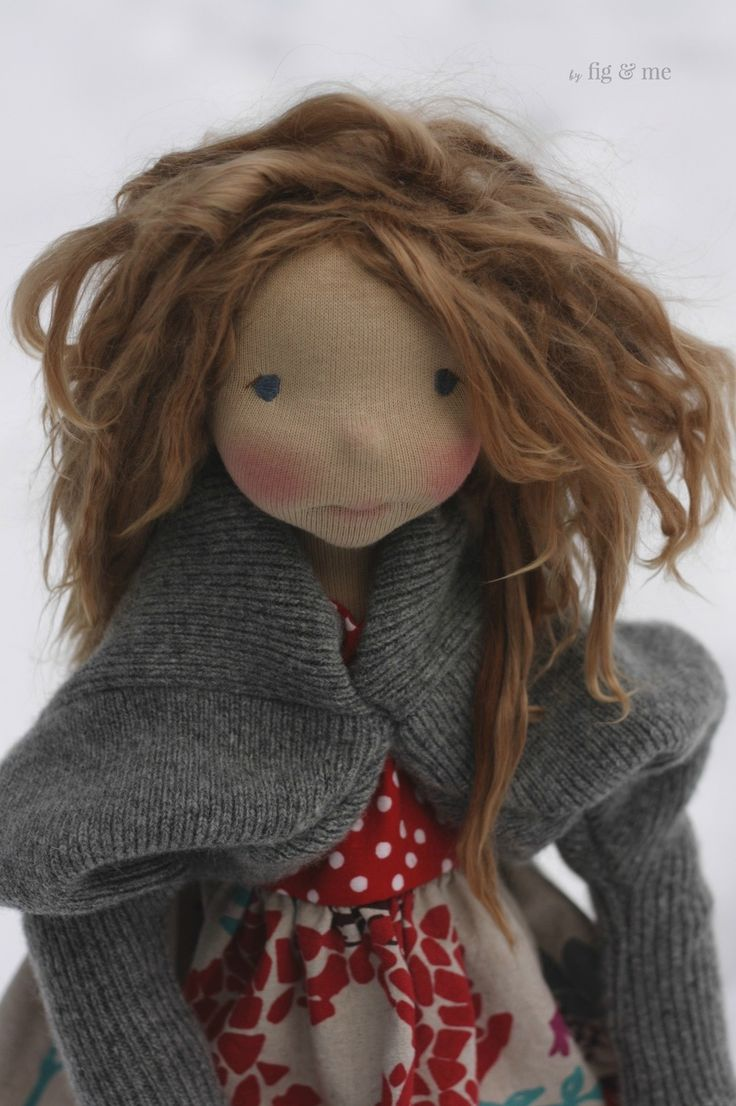 Sakasu, a natural fiber art doll by Fig and Me, wearing her knitted lambswool asymmetric cardigan and her linen top.
