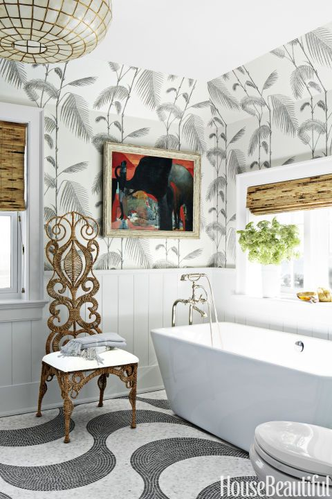 This spa-inspired bathroom by Colleen Bashaw has a Claire bathtub from Signature Hardware, Kohler's Pinstripe fixtures and Cole & Son's Palm Leaves wallpaper. Click through for a ton of bathroom inspo.