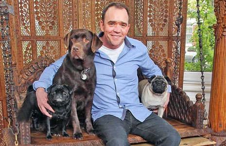 Todd Carty ex Eastenders start Mark Fowler with his two pugs & labrador