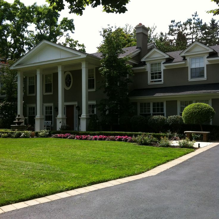Formal garden: boxwood and yew hedges, carpet roses, dogwood trees, and tiered fountain