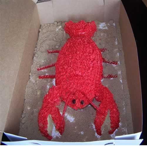 The LOBSTER A Cut-Up Cake Created and decorated by Kellie Sprunk Made using a Football Cake Pan Kellie Marie writes: This is a Lobster cake was made it for my sister, Chelsie's bridal shower and is actually my practice cake...the 'real' one soon to be made. The bridal shower theme is a Lobster Fest... the bride and groom have a thing about lobsters because they mate for life which means they are each o...