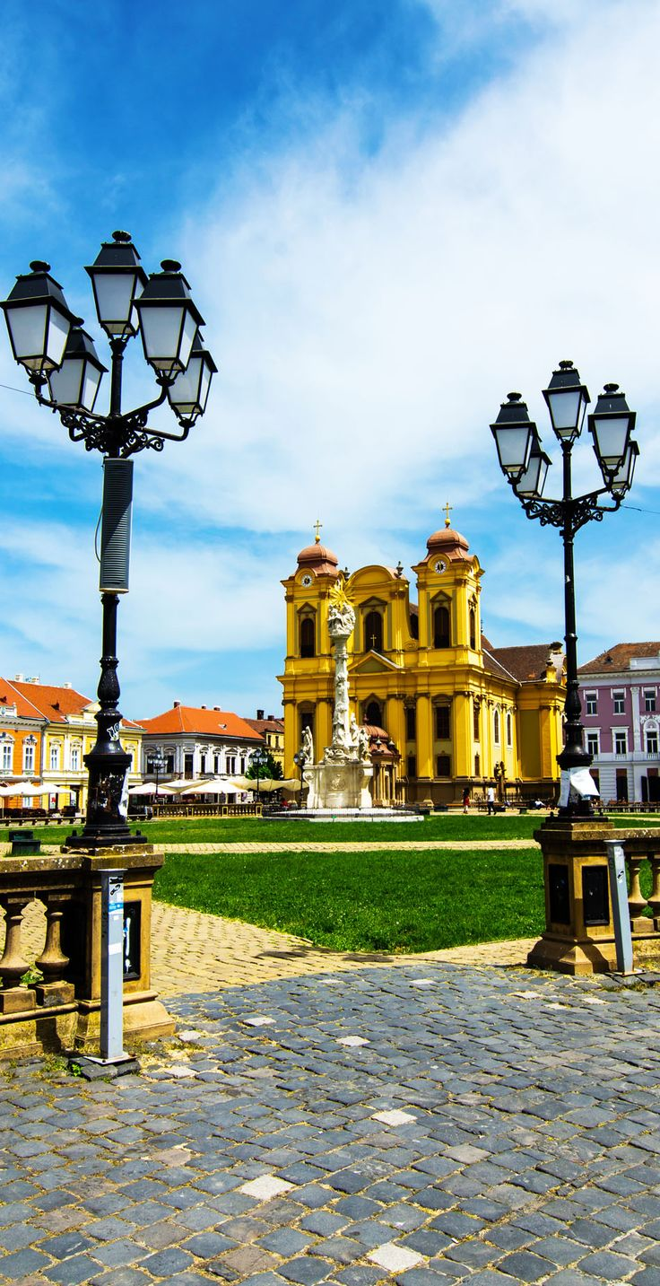 Unirii Square in Timisoara, Romania with Roman Catholic Episcopal Church | Discover Amazing Romania through 44 Spectacular Photos