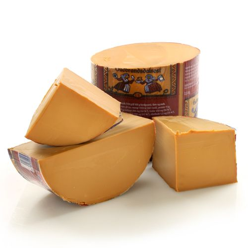 Gjetost is a very distinct Norwegian cheese that we tried when we visited a few years ago. It's mild, hard(ish) and waxy (similar to smoked Gouda), and tastes of ... caramel, or one might say butterscotch! A real conversation starter for your cheese plate!