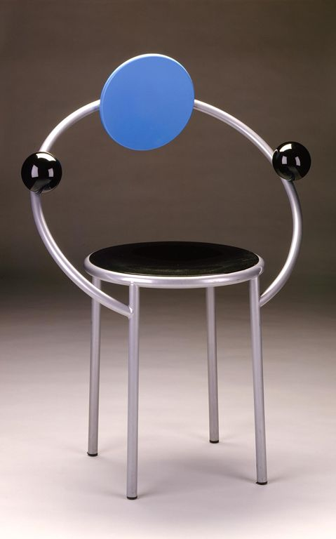 """Michele De Lucchi (Italian, b. 1951)  Produced for Memphis (design group) (Milan, Italy, established 1981)  """"First"""" Chair, designed 1983  Steel, lacquered wood, metallic paint, rubber  35 1/2 x 26 x 18 in. (90.17 x 66.04 x 45.72 cm)"""