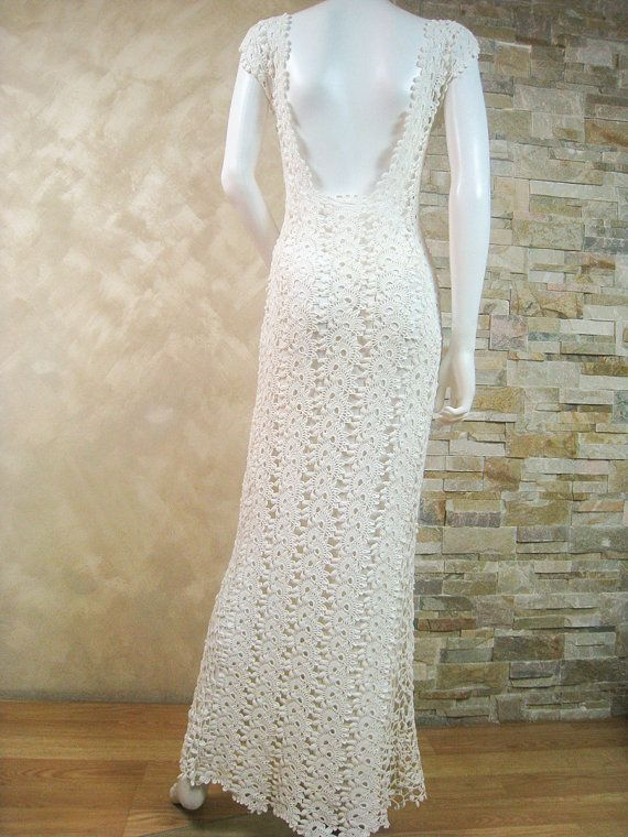 GABRIELA - CROCHET LACE WEDDING DRESS MADE BY HAND IN SPAIN ...an exclusive made by hand crochet lace dress for a special occasion... The finished product in a single copy.  Bust 38-39 Waist 30-32 Hip 40-42 Length 57  Click here to see of other items in my shop:  https://www.etsy.com/shop/LecrochetArt