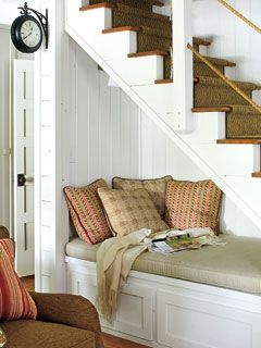 A reading nook nestled under the stairs. I love this so much. Anyway to add a little reading space just makes me want to do a little happy dance.
