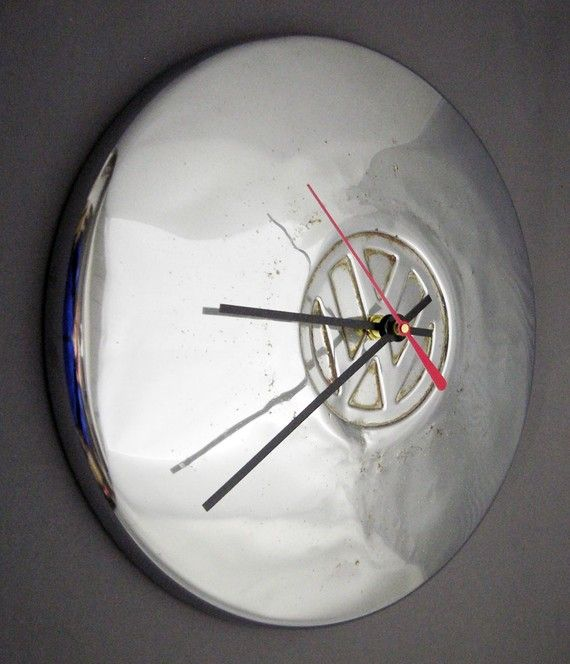 Hey, I found this really awesome Etsy listing at http://www.etsy.com/listing/62449359/vw-beetle-wall-clock-volkswagen-bug