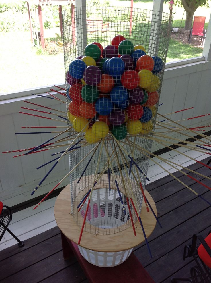Giant Kerplunk - cost about $45.00. 20 for balls, 15 for wire, 10 for dials. Set it on a clothes basket to keep from having to pick up 100 balls everytime you play it.