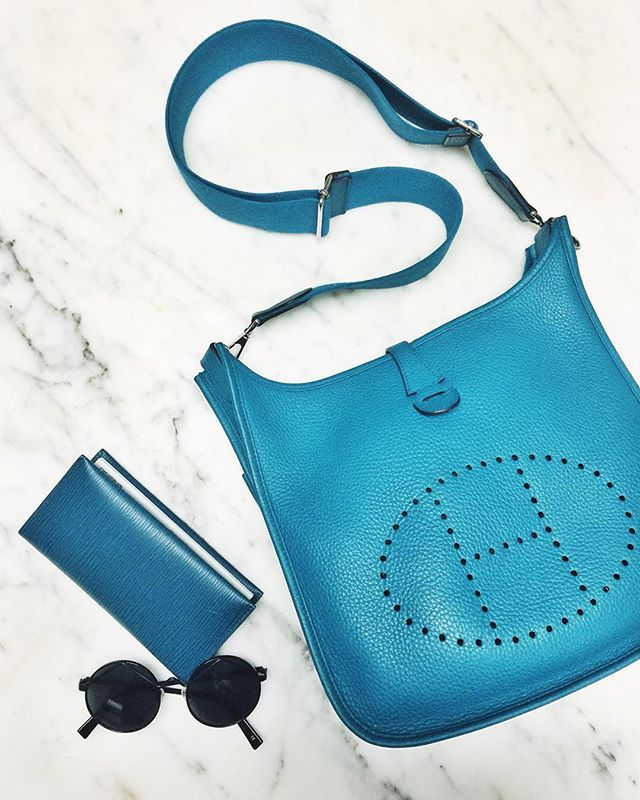 Serious bag envy in the office today. Loving the cool color of this Hermes bag and Louis Vuitton checkbook cover.