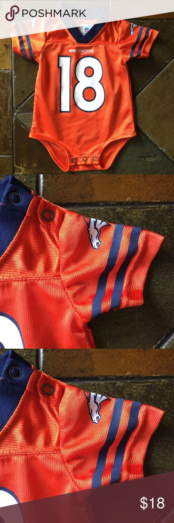 Peyton Manning one piece football Baby 0-3 Months This is a great little Peyton Manning one piece shirt in size 0-3 Months.  Worn Once, looks new!  Orange with Manning in the back.  By NFL teams. NFL Teams Shirts & Tops
