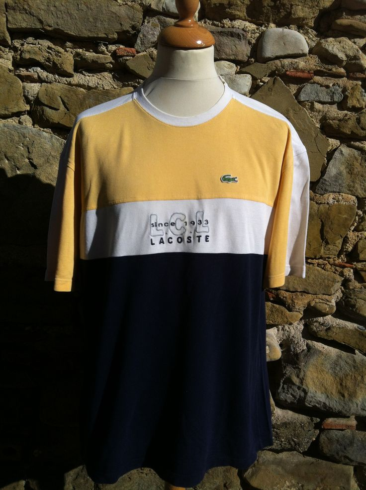 One of three rare LCL Lacoste Pieces. this hevay cord threaded Top has the neat embroidery to chest and vibrant pastel Yellow bar, dont miss any of these! No r