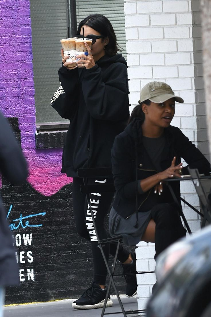Vanessa Hudgens wearing Quay Eyeware Kitti Sunglasses, Spiritual Gangster Namaste All Day Leggings and Kanye West Saint Pablo Wolves Black Hoodie