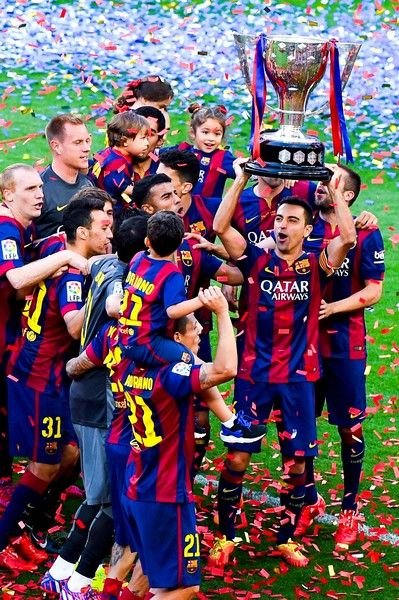 FC Barcelona players celebrate with La Liga trophy at the end of the La Liga match between FC Barcelona and RC Deportivo de la Coruna at Camp Nou on May 23, 2015 in Barcelona, Catalonia.