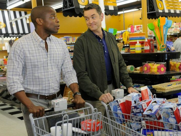 """Gus bumps in to Lassiter, who bought up all of the light bulbs, at the supermarket in """"Neil Simon's Lover's Retreat."""""""