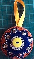 Orange bauble w blue flower