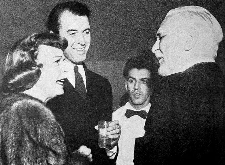 Jimmy Stewart, Margaret Sullavan and Frank Morgan at an Ambassador Hotel party, late 1940s