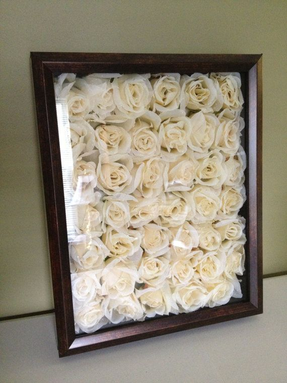 Floral Shadow Box, it'd be an awesome way to always have your wedding bouquet flowers. I love this idea.