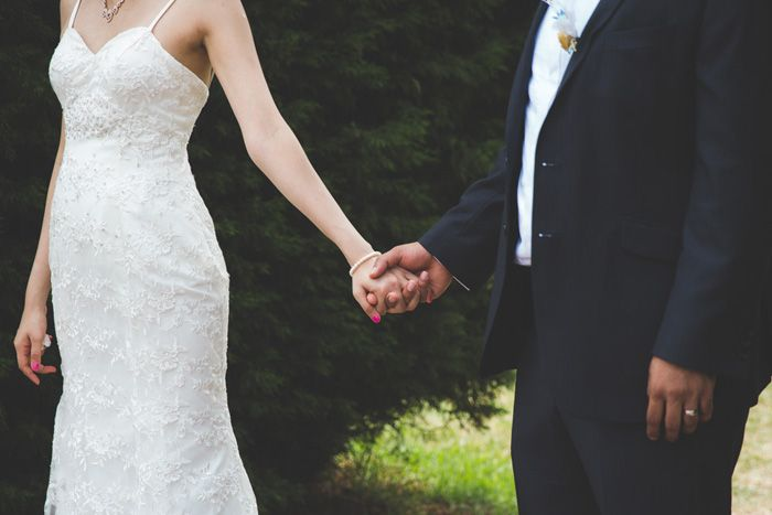 groom and bride holding hand