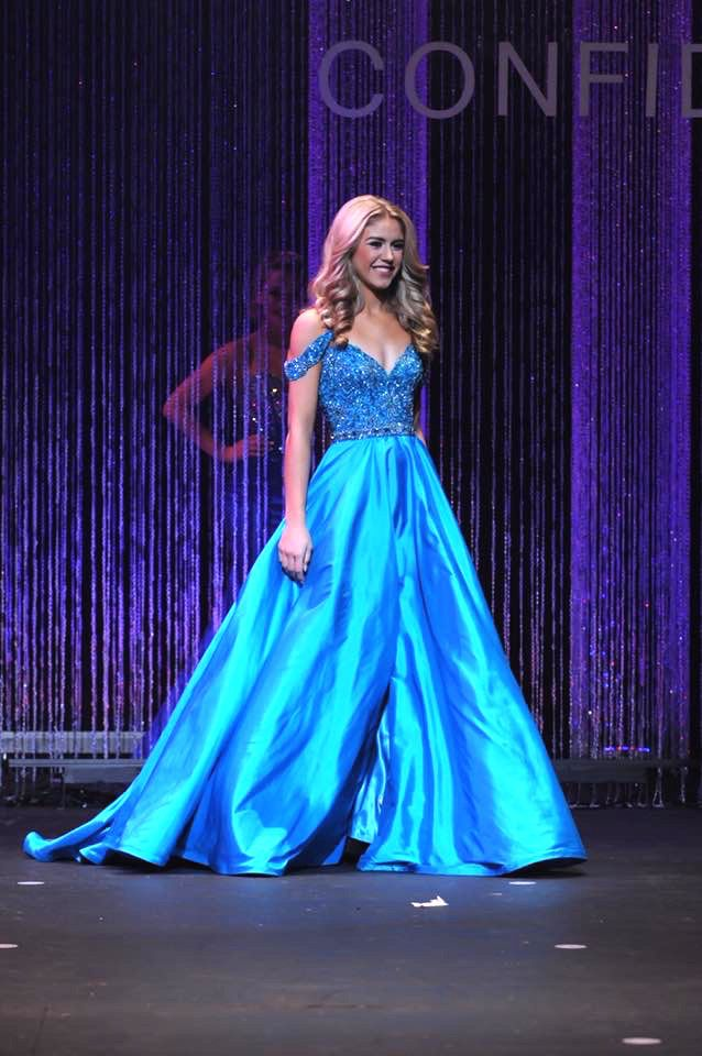 Tori Trittin will be representing Minnesota at the Miss Teen USA pageant this upcoming summer. In a polished and youthful look, she captivated the judges and took home the crown.  The Color  This bright shade of blue reads beautifully under the stage lights, especially against Tori's blonde hair. The iridescent skirt picks up dark blue and purple tones on stage to add another layer of dimension.  Bright colors like this one are excellent choices for Teen contestants because they showcase…