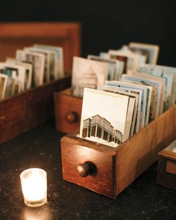 inspiration | have guests sign vintage postcards instead of a guestbook and frame your favorites | via: martha stewart weddings