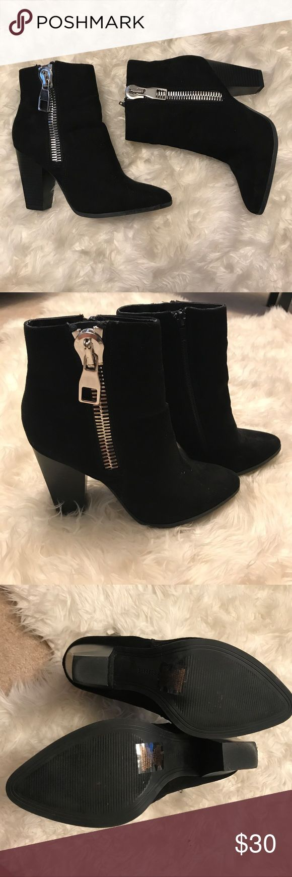 """Black Express Boots Black boots with large silver side zipper. Around a 3.5"""" heel. Size 7. Small scuff marks on the inside of right shoe (as pictured).  Zipper on inside shoe. Express Shoes Heeled Boots"""